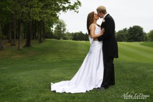 Bride-and-Groom-on-9th-Fairway-Kissing